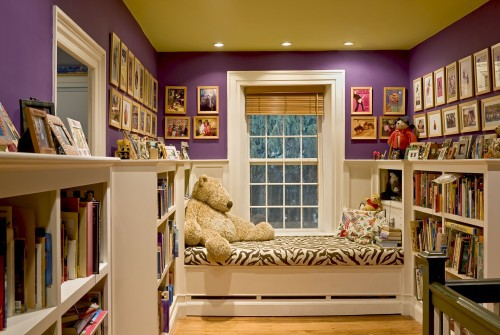kids reading area with book storage and window seat