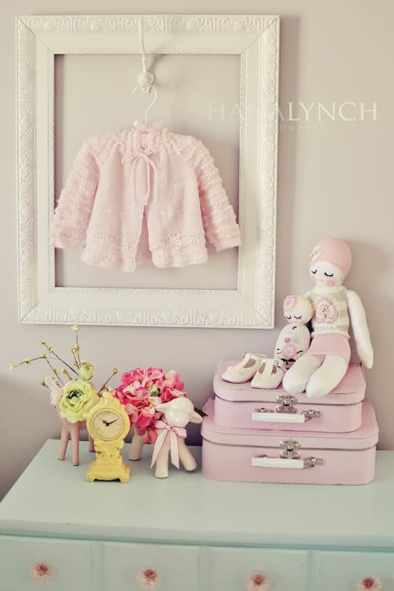 heirloom baby clothing display for baby nursery ideas