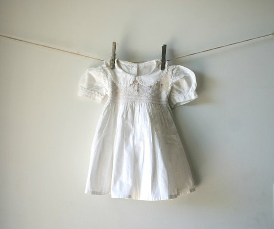 baby nursery ideas with heirloom baby clothing display