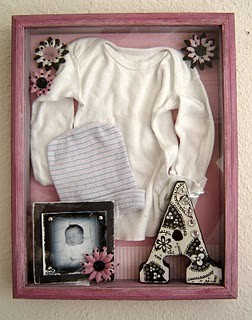 baby nursery ideas with heirloom baby clothing display in shadowbox