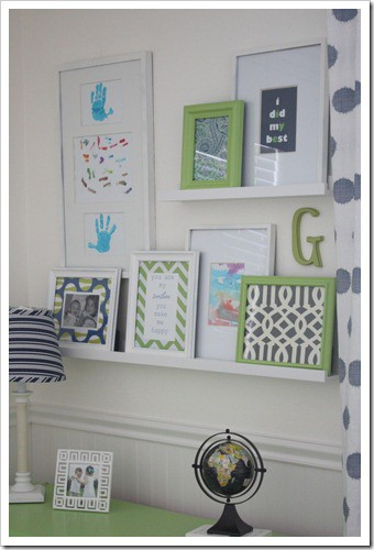 family photo display with frames sitting on shelves