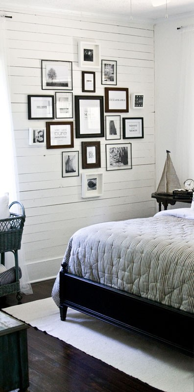 family photo display in vintage guest room