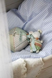 stuffed soft baby toy in cradle