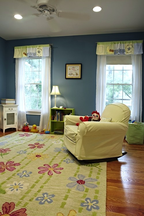 Wonderful Baby Nursery Floor Idea With Floral Area Rug On Wood Floor