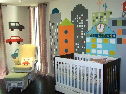 modern baby nursery with cityscape wall mural and glider