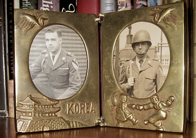 brass frame with military service photos