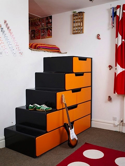 Design room for kids with cubbyhole bed and storage in stairs
