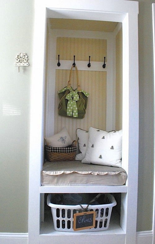 Small space mudroom uses entryway closet for storage