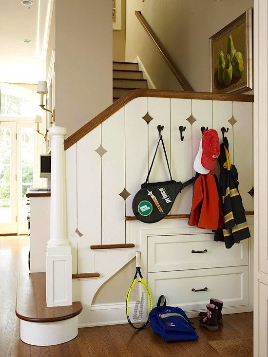 small space mudroom uses under stairs for storage