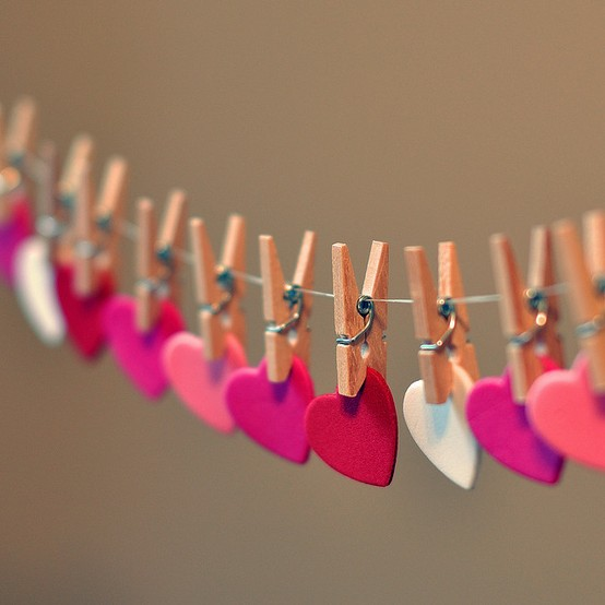 valentine art for kids with hearts pinned on clothes line