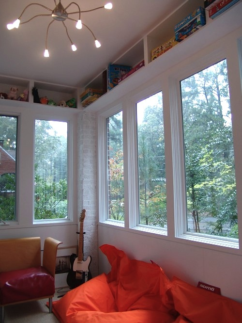 Design room for kids with over window game storage