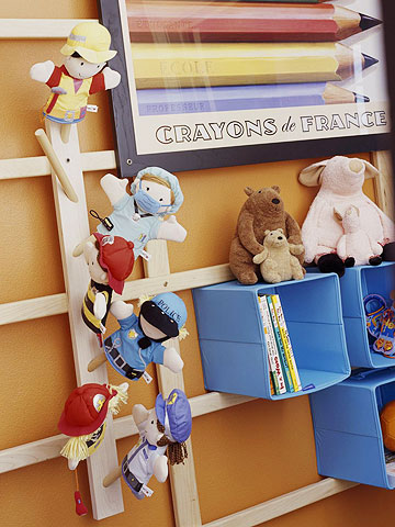 Design room for kids with Wall storage grid in playroom