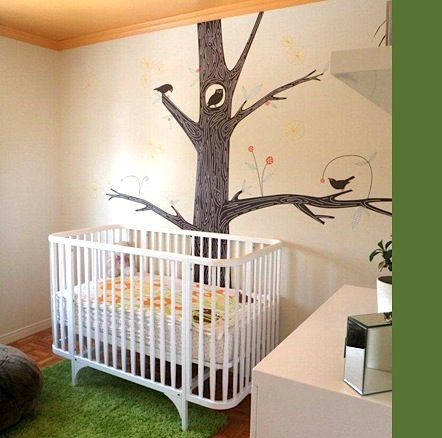 baby nursery ideas with round contemporary crib and tree mural