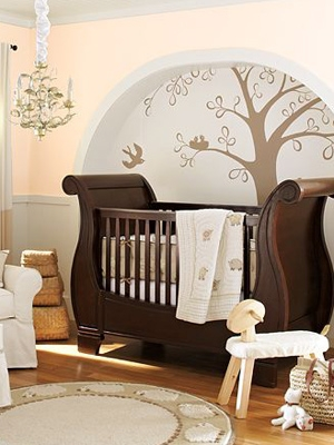 nursery design with painted tree in niche for wall design