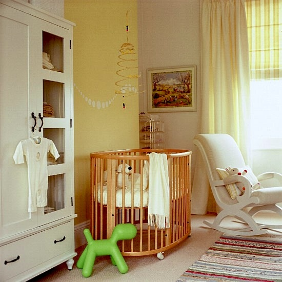 nursery design with upholstered rocking chair and round crib - Rocking Chair Nursery