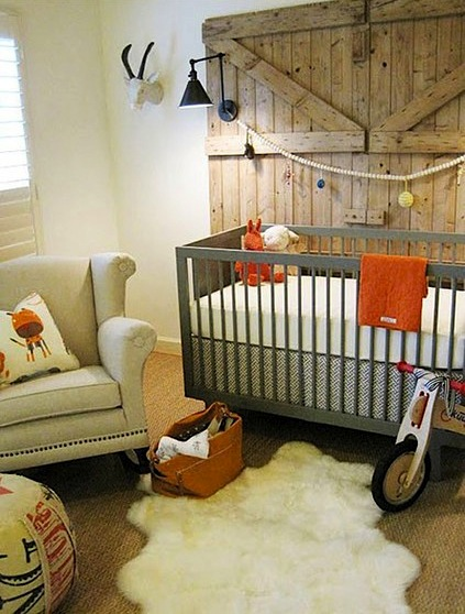 nursery design with rustic theme and wing back rocking chair