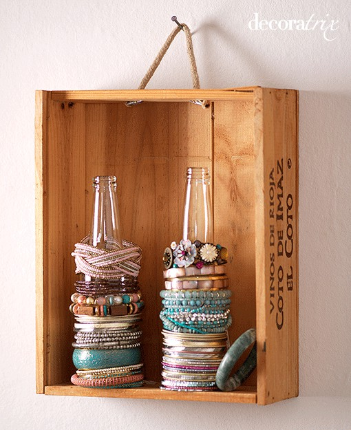 teenager room idea for vintage bracelet storage on glass pop bottles inside vintage crate