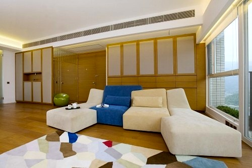 family room noise control with acoustic panels on cabinets