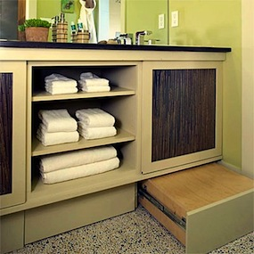kids bathroom storage idea for under counter open shelf towel storage and step stool