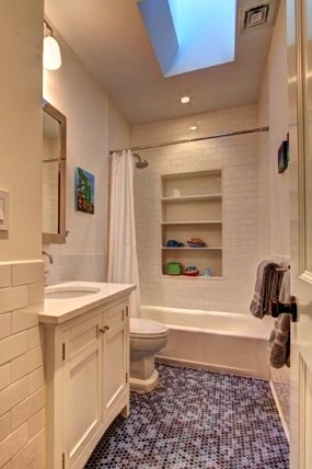 in-wall storage shelves for kids bathroom idea
