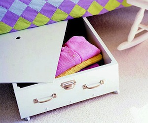 kids room storage idea with moveable under bed storage drawer on wheels