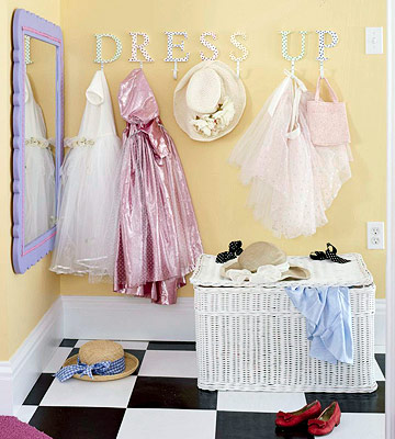 girls room dressup idea with storage basket and hanging pegs and mirror