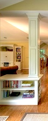 open shelves for family room storage in built-in divider