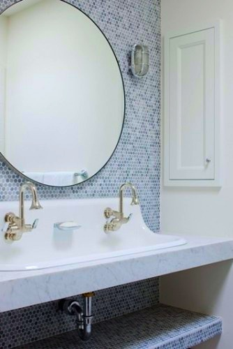 kid friendly bathroom with trough sink and undercounter storage