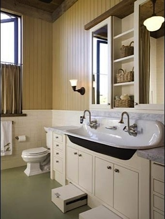 kid friendly bathroom with trough sink and undercounter step stool