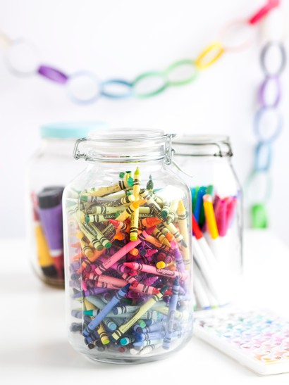 storage idea for activity center with mason jars for crayons