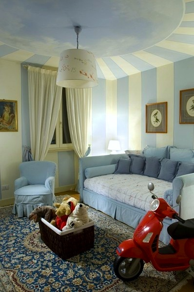 painted striped walls in baby nursery