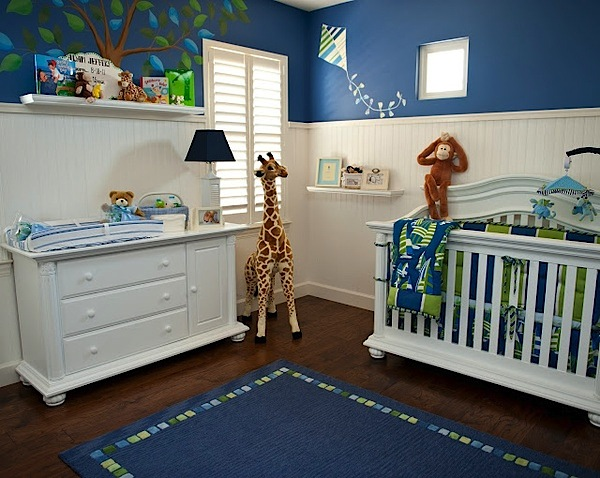 dark blue paint above white beadboard walls in baby nursery