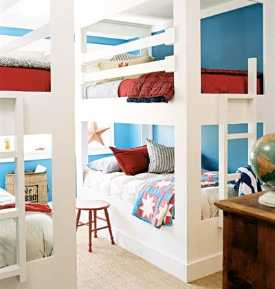 blue walls and red bedding in kids bunk room at grandmas