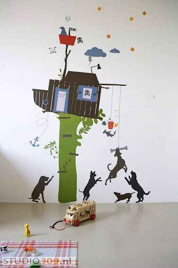 playful dogs below treehouse wall mural for playroom wall art idea