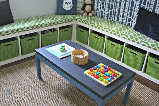 cubby storage below built-in seat with table for kids activity center
