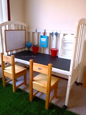 chalkboard surface table made from recycled crib for kids activity center