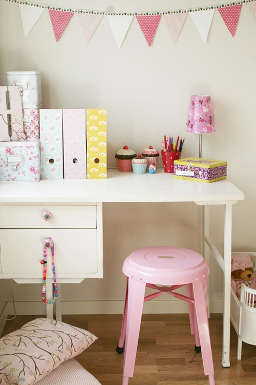 pink metal stool used at kids desk for activity center and kids artwork project