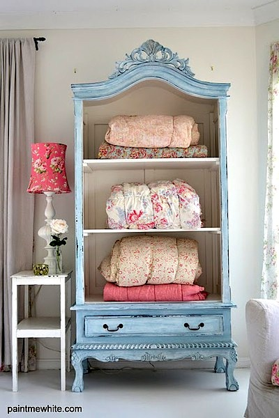 reclaimed armoire with doors removed used in teen gril room for blankt storage idea