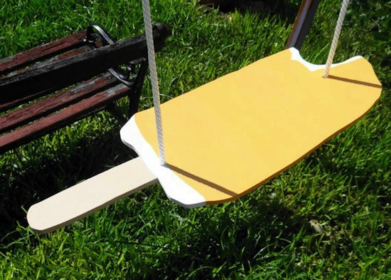 hand crafted swing seat for kids looks like creamsicle