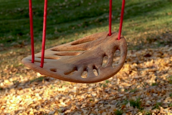 swing seat shaped like leaf hand crafted from solid wood