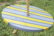 painted round swing seat for rope tree swing