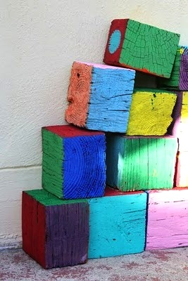 kids backyard activity ideas with painted recycled wood blocks