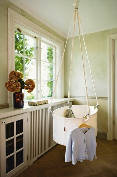 baby nursery cradle suspended from ceiling