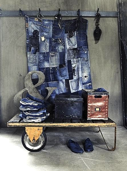 blue jean pockets recycled into pocket storage wall hanging