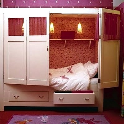 bed in a box with hinged folding doors is a simple solution any kid