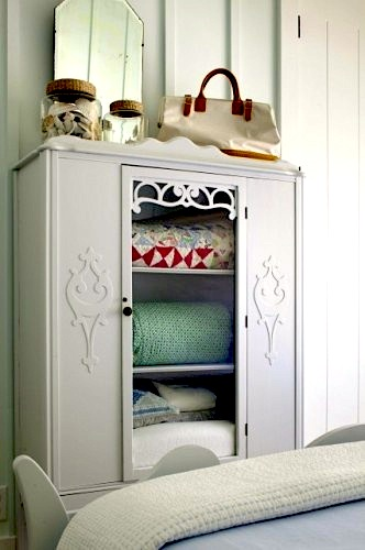 kids room storage ideas with vintage armoire