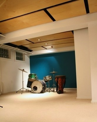 basement recreation room for teens with suspended wood ceiling
