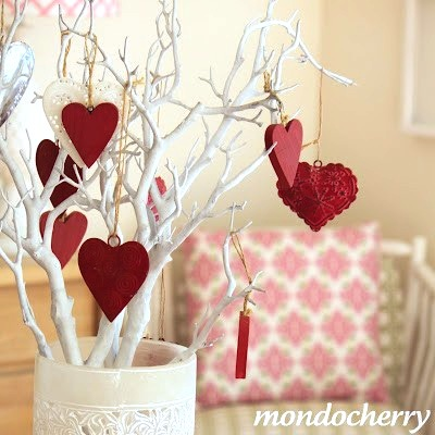 red hearts hanging in white tree branches