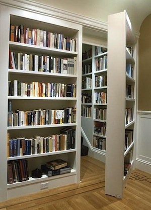 family library in staircase and moveable bookcase