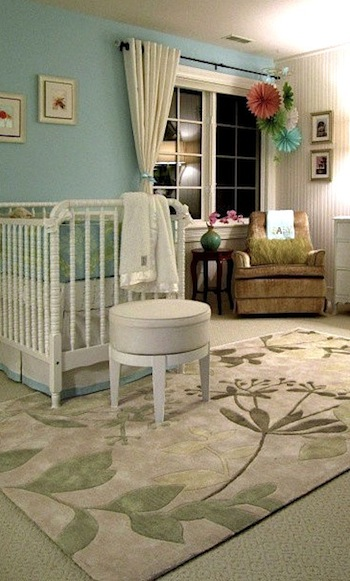 chic floral area rug on baby nursery floor